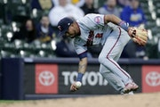 Luis Arraez was unable to field a ground ball during the third inning Thursday. Later defensive lapses cost the Twins on Opening Day.