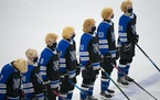 The Dodge County Wildcats had their playoff hair on display during team introductions. ] JEFF WHEELER • jeff.wheeler@startribune.com