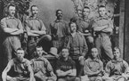 """John W. """"Bud"""" Fowler, seen here at center, stood with his teammates in Keokuk, Iowa, where he played after leaving Stillwater."""