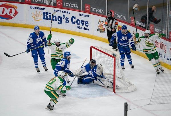 Edina Hornets forward Jane Kuehl (11) celebrates her second goal of the game on Minnetonka Skippers goaltender Brynn DuLac (1) in the second period. ]