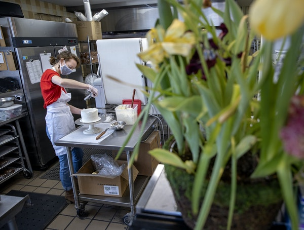 Anne Andrus, who has owned Honey + Rye Bakehouse for more than seven years, worked the kitchen, Friday, March 26, 2021 in St. Louis Park, MN.  She has