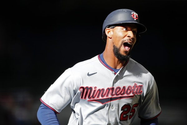 Byron Buxton hit a long home run and walked twice in a strong debut.