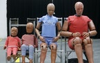 Full-scale anthropomorphic test devices — aka crash test dummies — representing a family were on display at Ford's development center.