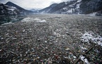 Plastic bottles and other garbage floats in the Potpecko lake near Priboj, in southwest Serbia, on Jan. 22. A United Nations report released on Feb. 1