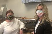 Claire Ferrara, right, president and majority owner of Standard Heating & Air Conditioning, with Dunwoody's Heather Gay.