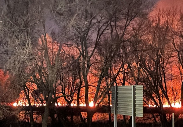 The flames from Friday night's fire in Richfield were visible from Crosstown Hwy. 62.