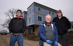 Gary Findell, center, with Dana Taylor, left, and Jim Erchul in St. Paul. NeuHus founder Findell plans to launch a modular-housing factory in the Midw