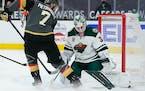 Wild goaltender Cam Talbot blocks a shot by Vegas defenseman Alex Pietrangelo during overtime on Thursday