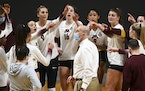 Gophers coach Hugh McCutcheon looked on as the team huddled up before a match earlier this season.