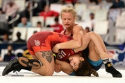 Emily Shilson (top), a three-time national champion at Augsburg, went 1-1 in Saturday's consolation bracket of the women's freestyle 50 kg class a