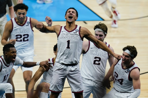 Gonzaga guard Jalen Suggs celebrates making the game winning basket against UCLA during overtime in the Final Four semifinal