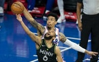Philadelphia 76ers' Danny Green, right, blocks a shot attempt by the Timberwolves' Jordan McLaughlin, left, during the second half