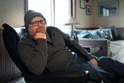 Andy Flosdorf sits in the chair in his home that he has spent most of the last year in. Flosdorf is a COVID Long Hauler. He got COVID in March 2020, a