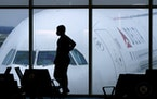 A passenger waited for a Delta Airlines flight at Hartsfield-Jackson International Airport in Atlanta in February.