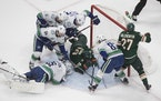 Canucks goalie Jacob Markstrom made a save against the Wild in an August 2020 game. Sixteen of the 22 players on Vancouver's active roster were on t