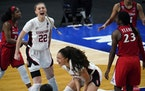 Stanford guard Haley Jones, center, and forward Cameron Brink (22) celebrated in front of Arizona guard Bendu Yeaney (23) as the Cardinal held off the
