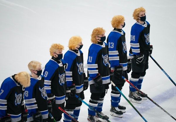 Dodge County brought some serious hair to the state hockey tournament.