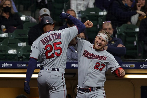 Byron Buxton (25) celebrates a solo home run with teammate Ryan Jeffers during the seventh inning on Saturday.