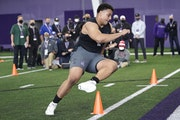 Northwestern offensive lineman Rashawn Slater participates in the school's Pro Day football workout for NFL scouts on March 9.