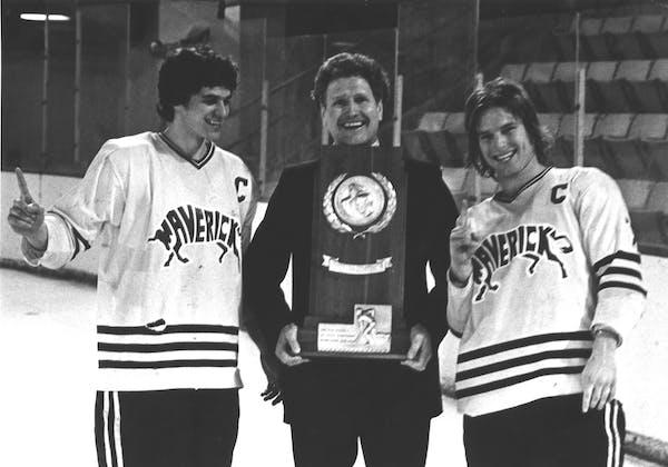 Don Brose holds Minnesota State's 1980 NCAA Division II men's hockey trophywith captain Steve Forliti (left) and Steve Loomis (right).