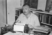"Ken Burns' documentary ""Hemingway,"" on the life of author Ernest Hemingway, airs this week on PBS. Above, Hemingway writes on his typewriter at"