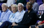 Hubert Davis (right, seated next to North Carolina basketball coach Roy Williams) will replace Williams, the Associated Press reported Monday. Davis,