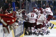 UMass celebrated its Frozen Four semifinal victory over Denver in the 2019 Frozen Four.