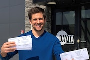 Luke Riordan, founder and chief executive officer of St. Cloud-based DAYTA Marketing, holds raffle tickets for a Big Brothers Big Sisters fundraiser.