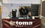 Toma Mojo Grill co-owners Paul Backer, left, and Michael Knox.