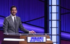 "Aaron Rodgers at the lectern for his guest host stint on ""Jeopardy!"""