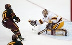 Gophers goalie Jared Moe made a save against Arizona State in January.