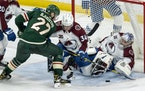 Colorado goalie Philipp Grubauer stops a shot by Nick Bjugstad of the Wild on Monday night. The Wild lost their fifth game in regulation to Colorado 5