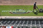 Grounds crew members prepare Target Field for the April 8 home opener Tuesday in Minneapolis.        ]                 DAVID JOLES • david.joles@sta