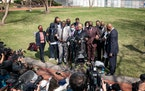 The Rev. Al Sharpton led members and supporters of the Floyd family in prayer outside the Hennepin County Courthouse on Tuesday.