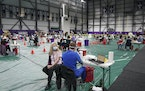 A woman sat waiting to be vaccinated at the Vikings Training Center tha had been converted into a site administering the newly available, single-dose,