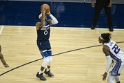Minnesota Timberwolves guard D'Angelo Russell (0) lines up a shot Monday.