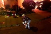 An image of Matthew Lee Rupert in front of a burning building in Minneapolis (Facebook) ORG XMIT: CgKql52krKbor-3jupD2