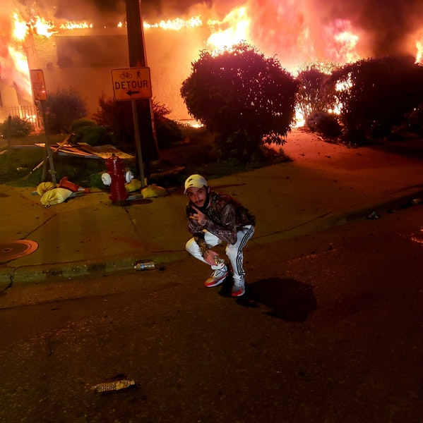 An image of Matthew Lee Rupert in front of a burning building in Minneapolis (Facebook) ORG XMIT: CgKql52krKbor-3jupD2