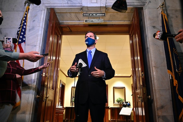 Kentucky Gov. Andy Beshear speaks to reporters following the signing of bills related to the American Rescue Plan Act at the Kentucky State Capitol in