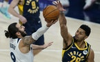 Minnesota Timberwolves' Ricky Rubio (9) has his shot blocked by Indiana Pacers' Jeremy Lamb (26) during the first half