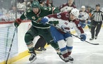 Jordan Greenway of the Minnesota Wild and Samuel Girard of the Colorado Avalanche chased the puck in the first period.