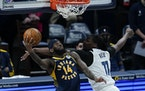 Indiana's JaKarr Sampson goes up for a dunk against the Timberwolves' Naz Reid during the first half
