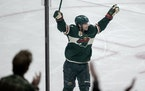 Kevin Fiala (22) of the Minnesota Wild celebrated a goal in the third period. Fiala had a hat trick in the game.