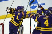 Minnesota State players surround goaltender Dryden McKay after beating the Gophers in the regional final.