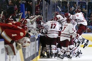 UMass players celebrated their Frozen Four overtime victory over Denver in 2019.