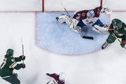 Kirill Kaprizov (97) of the Minnesota Wild shot the puck past the foot of Colorado Avalanche goalie Philipp Grubauer on Wednesday.