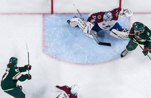 Kirill Kaprizov (97) of the Minnesota Wild shot the puck past the foot of Colorado Avalanche goalie Philipp Grubauer on Wednesday.