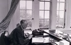 Historical photo of author Sinclair  Lewis writing in the study of his Duluth home in 1944.   Original photo shot by Minneapolis Star-Journal photogra