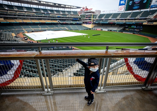Thomas Christensen, 2, of Savage looked back at his father Drew after taking in the scene at Target Field for Twins opener.