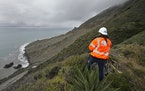 In this May 25, 2017, file photo, Cal Trans public affairs officer Jessica Biro photographs the southern end of the Mud Creek slide as it covers Highw